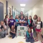 Gina with Girl Scouts participating in an environmental activity.